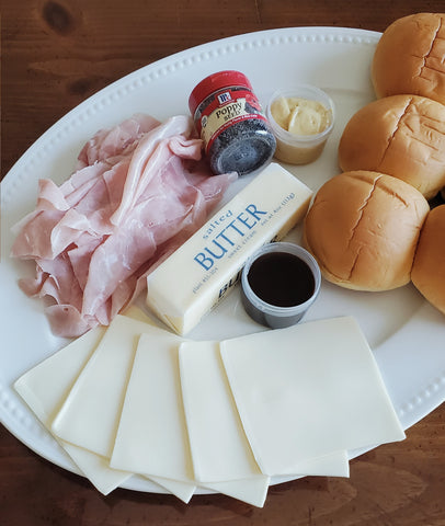 Baked Ham & Cheese Sliders ingredients on a plate ready for assembly