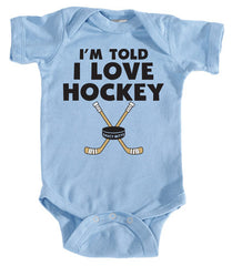 i'm told i love hockey infant bodysuit light blue