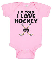 i'm told i love hockey infant bodysuit pink