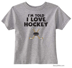 I'm Told I Love Hockey Toddler Shirt heather gray