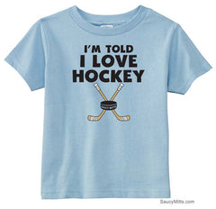 I'm Told I Love Hockey Toddler Shirt light blue