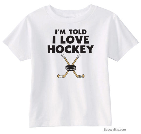 I'm Told I Love Hockey Toddler Shirt white