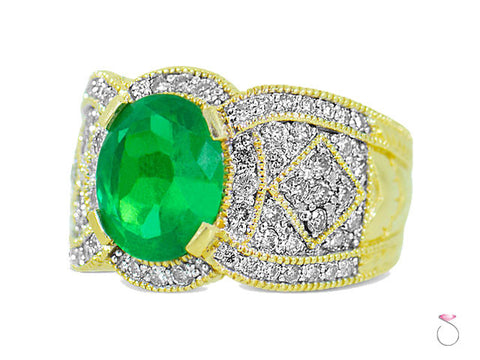 4.00ct Oval cut Emerald and Diamond Ring in 14K Yellow Gold