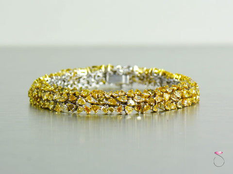 Gorgeous 14.25 ct. Fancy Yellow Diamond Tennis Bracelet in 18K