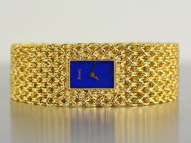PIAGET LADY'S 18K GOLD BRACELET WATCH WITH BLUE LAPIS LAZULI DIAL