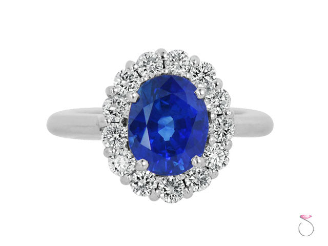 Blue sapphire diamond halo ring in 18K