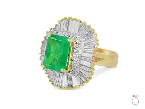 6.00 ct Emerald Ballerina Ring with 3.00 ct Diamond Halo in 18K