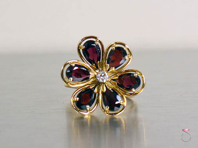 Vintage Garnet & Diamond Flower Cocktail Ring in 14K yellow gold