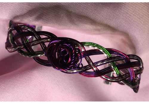 Sensuous multi-colored jewel tones and silver wire woven bracelet features a single, magenta and purple wire rose for an elegant statement but suitable for regular wearing.