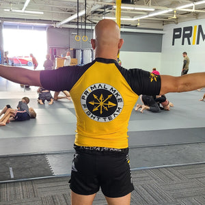 Load image into Gallery viewer, Primal Rash Guard - Yellow/Black Team - Primal MKE