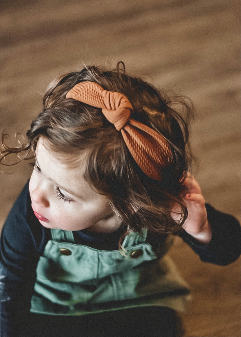 toddler sized knot headband for kids in burnt orange color
