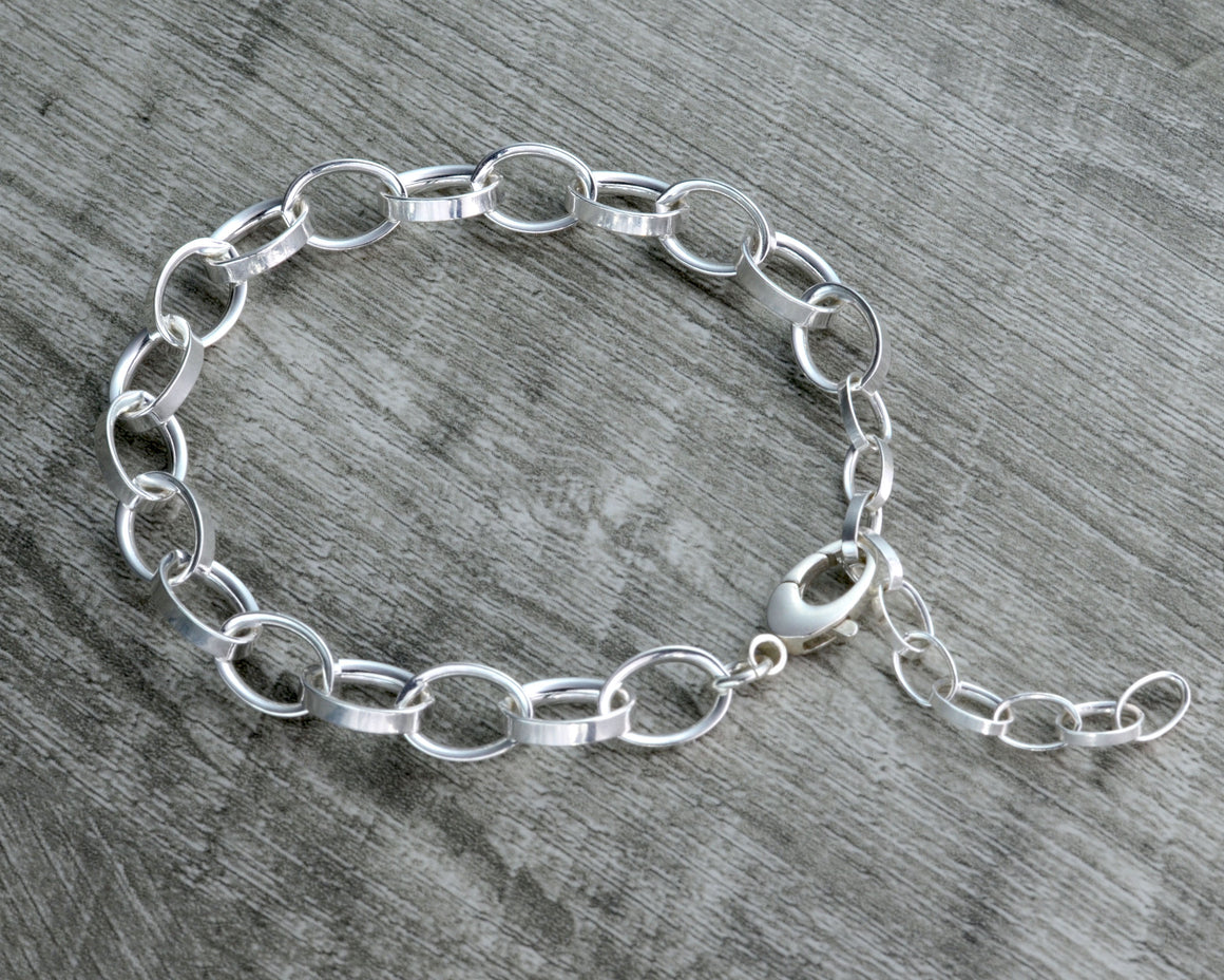 STERLING SILVER CHARM BRACELET WITH EXTENDER