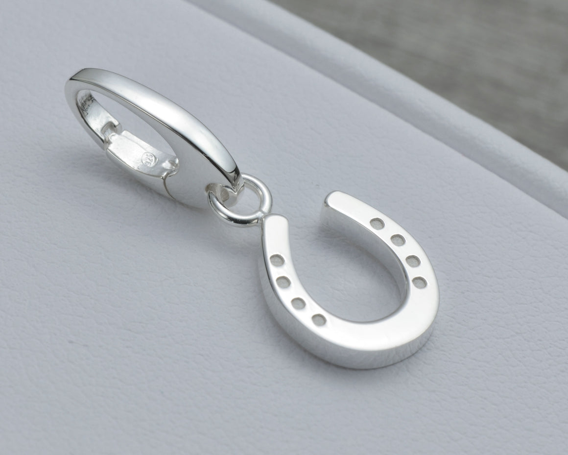 HORSESHOE CHARM IN STERLING SILVER