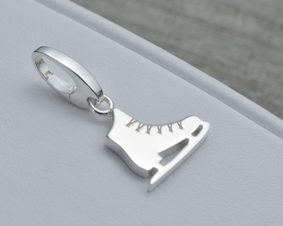 SKATING CHARM IN STERLING SILVER