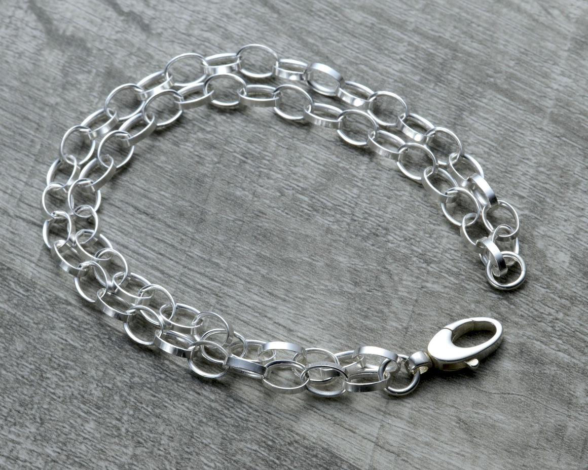 LAYERED STERLING SILVER CHARM BRACELET