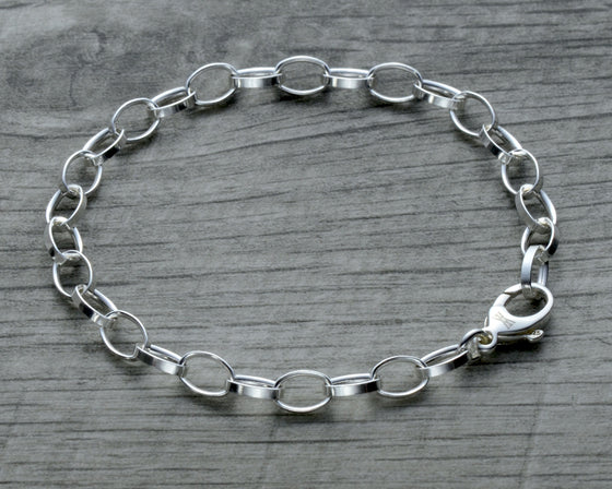 charm bracelet in sterling silver with lobster clasp