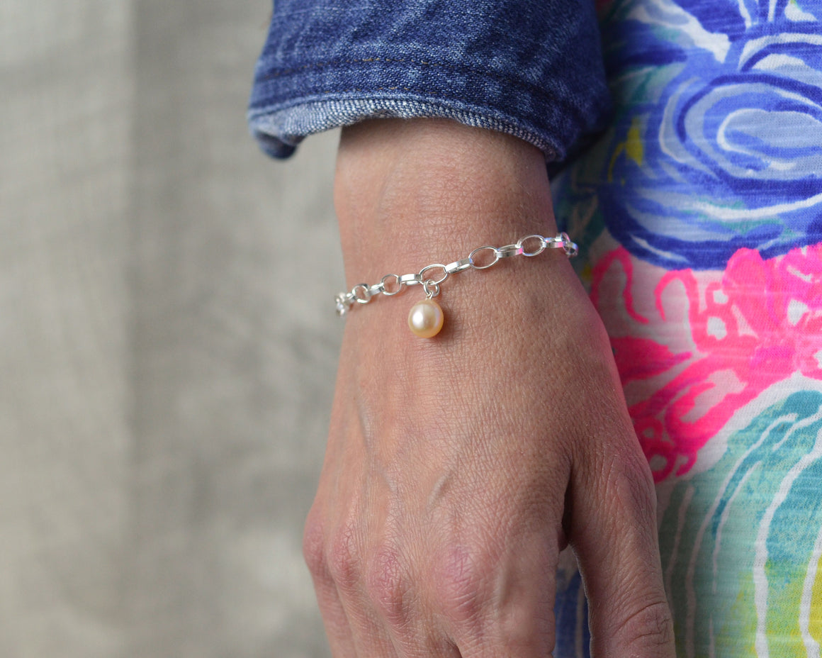 charm bracelet in sterling silver with pearl pendant