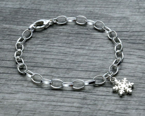 Snowflake charm bracelet in sterling silver with clasp