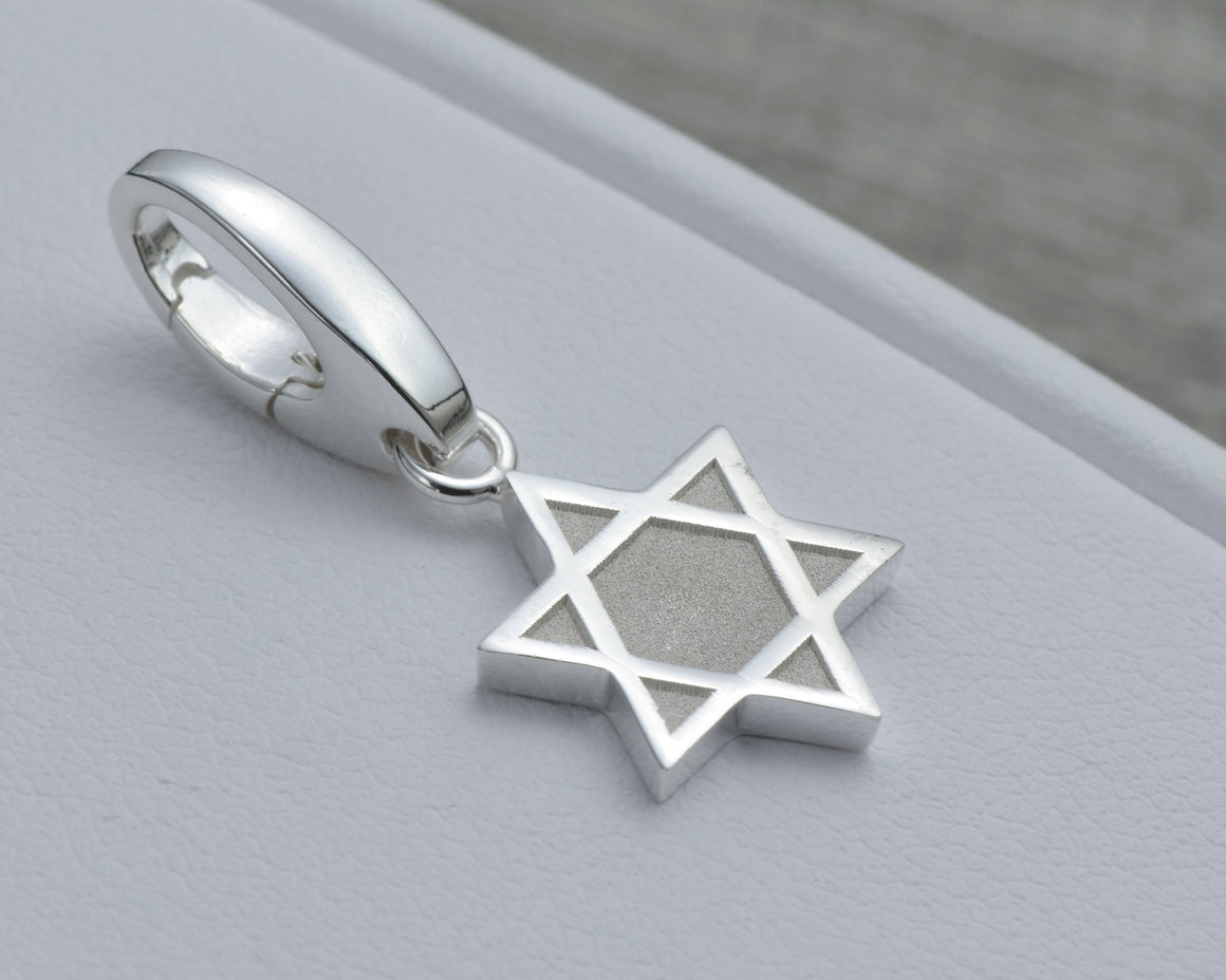 STAR OF DAVID CHARM IN STERLING SILVER