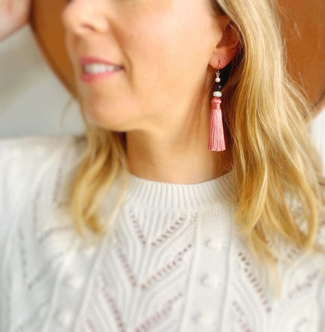 tassel earrings with white sweater and fall hat