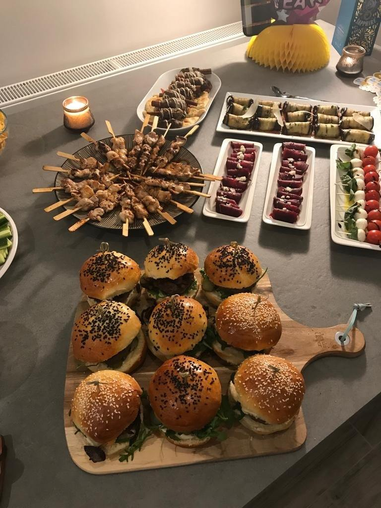 Image of Yasmin Bakery & Catering amazing food selection with mini burgers and chicken thigh skewer for a new year party