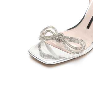 CRYSTAL BOW HEELED SANDALS