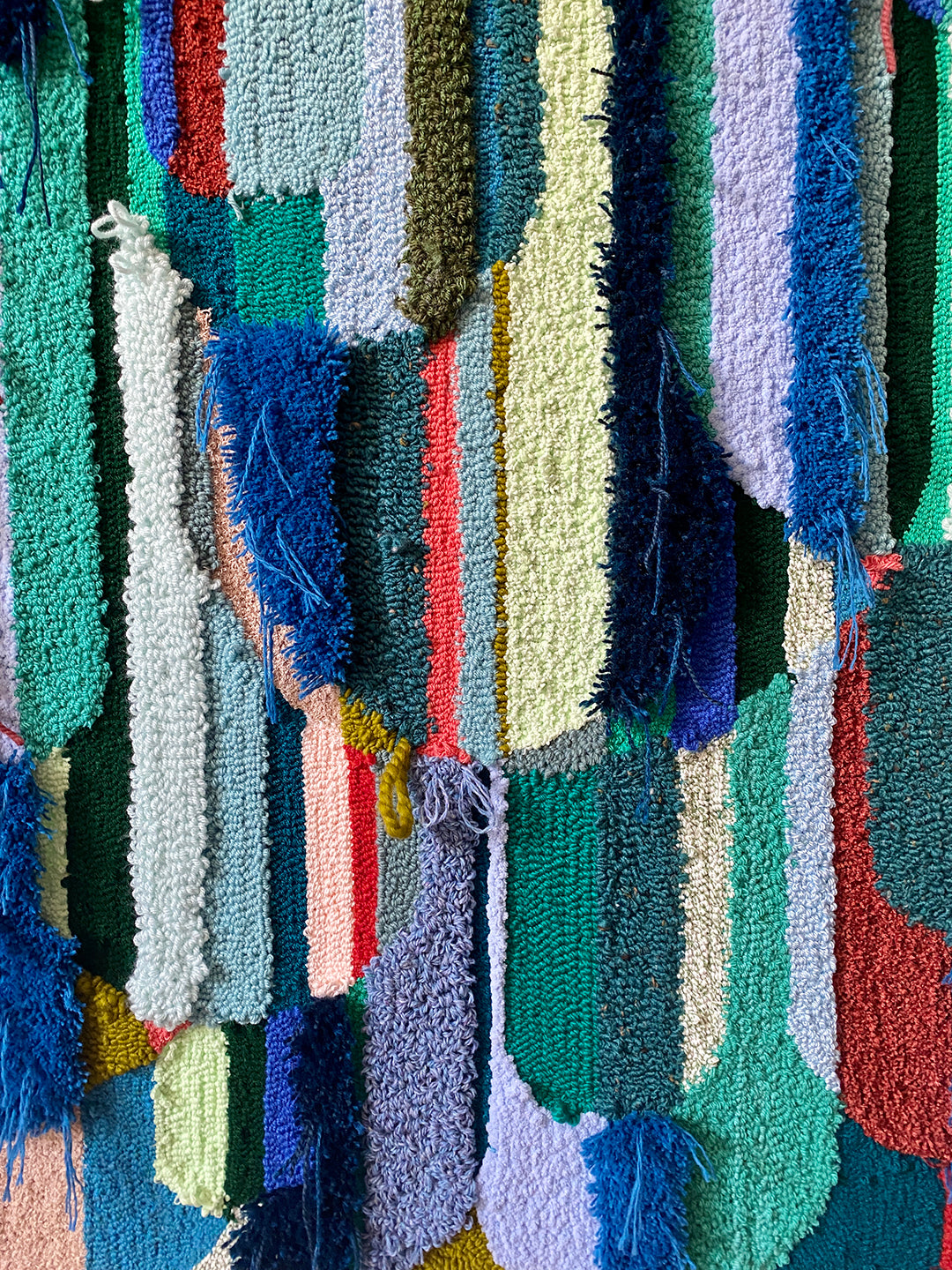 Trish Andersen fiber art detail greens, blues, coral