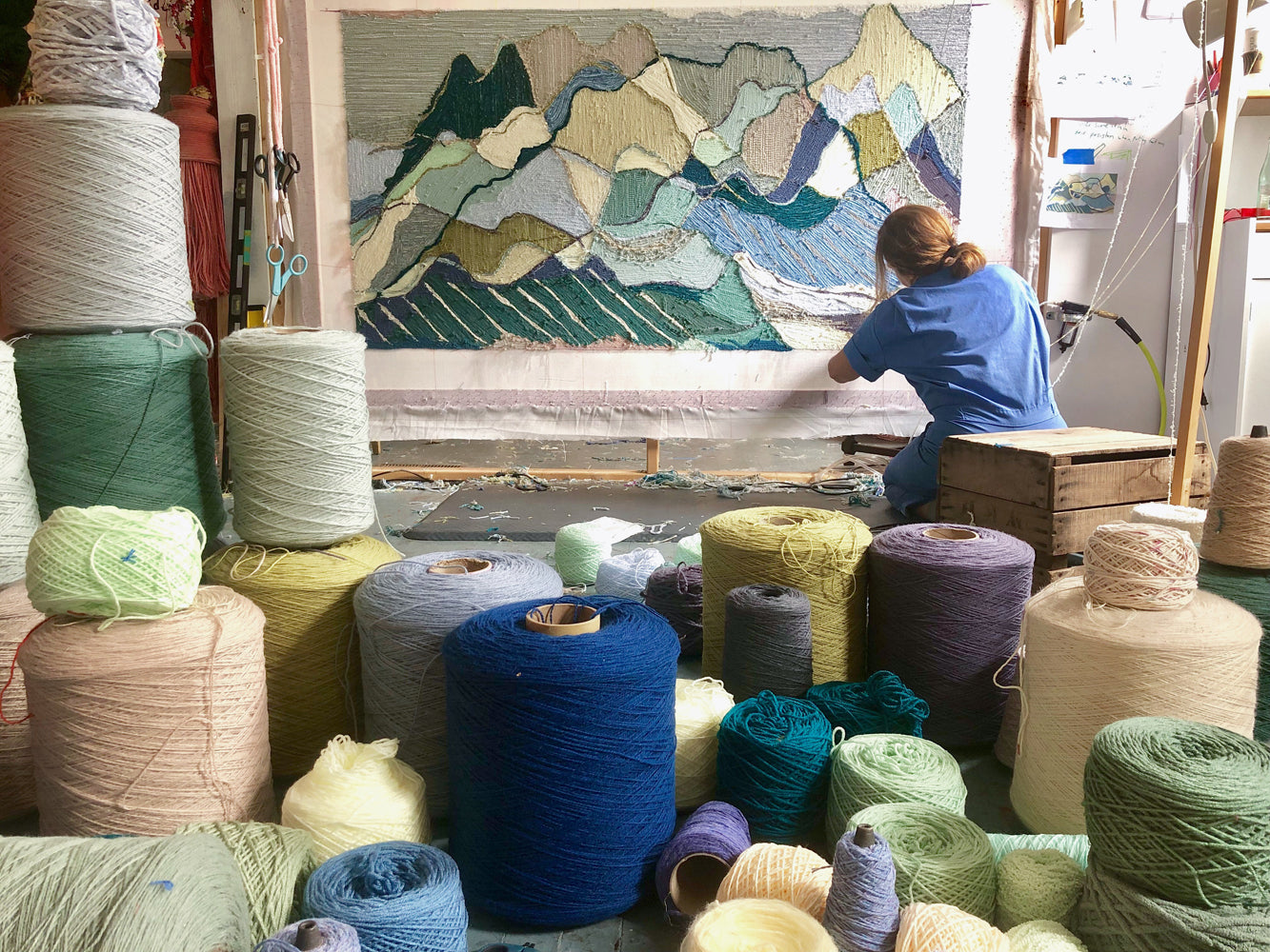 Fiber artist Trish Andersen working on large scale tufting