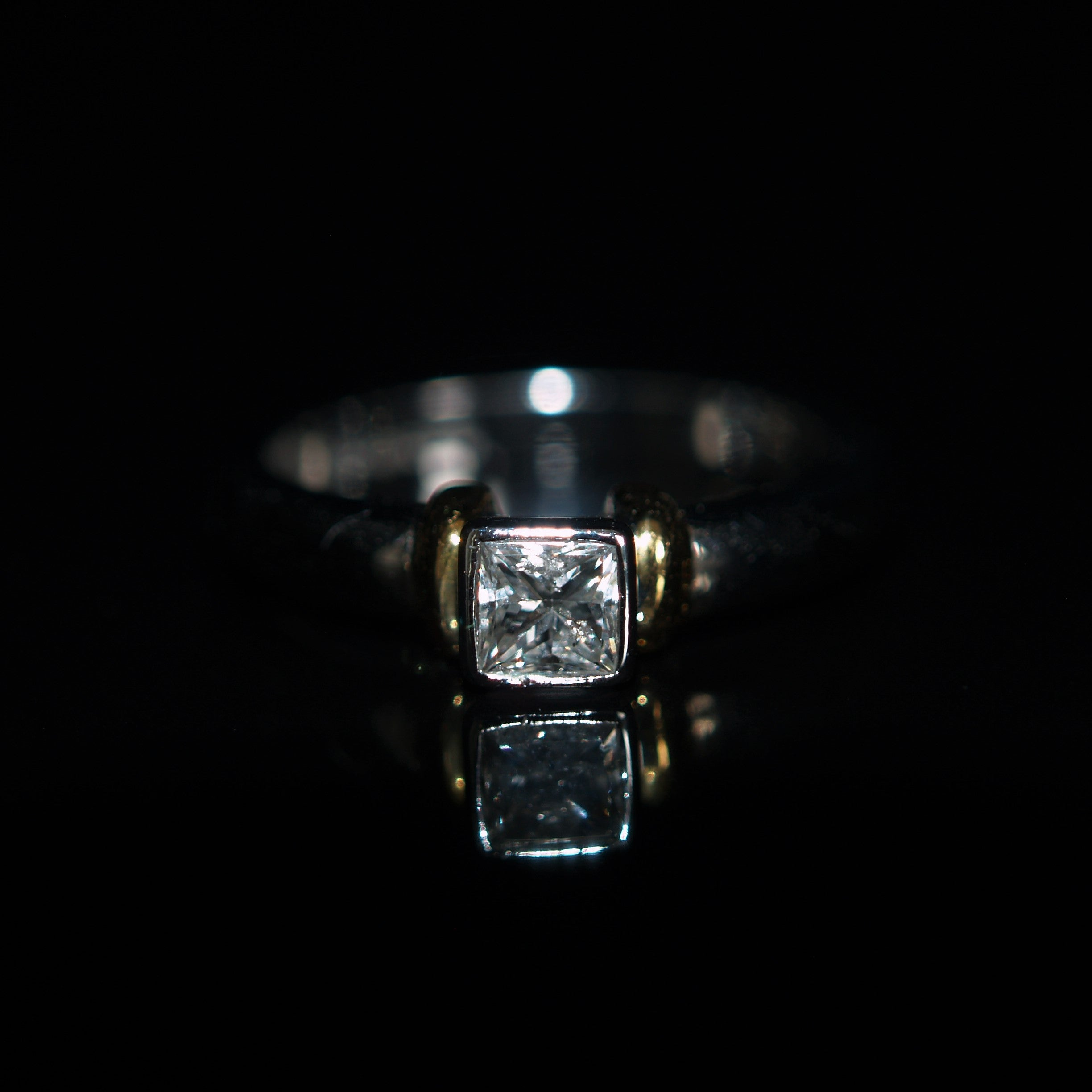 18ct White/Yellow Gold Princess Cut Solitaire Diamond Ring.