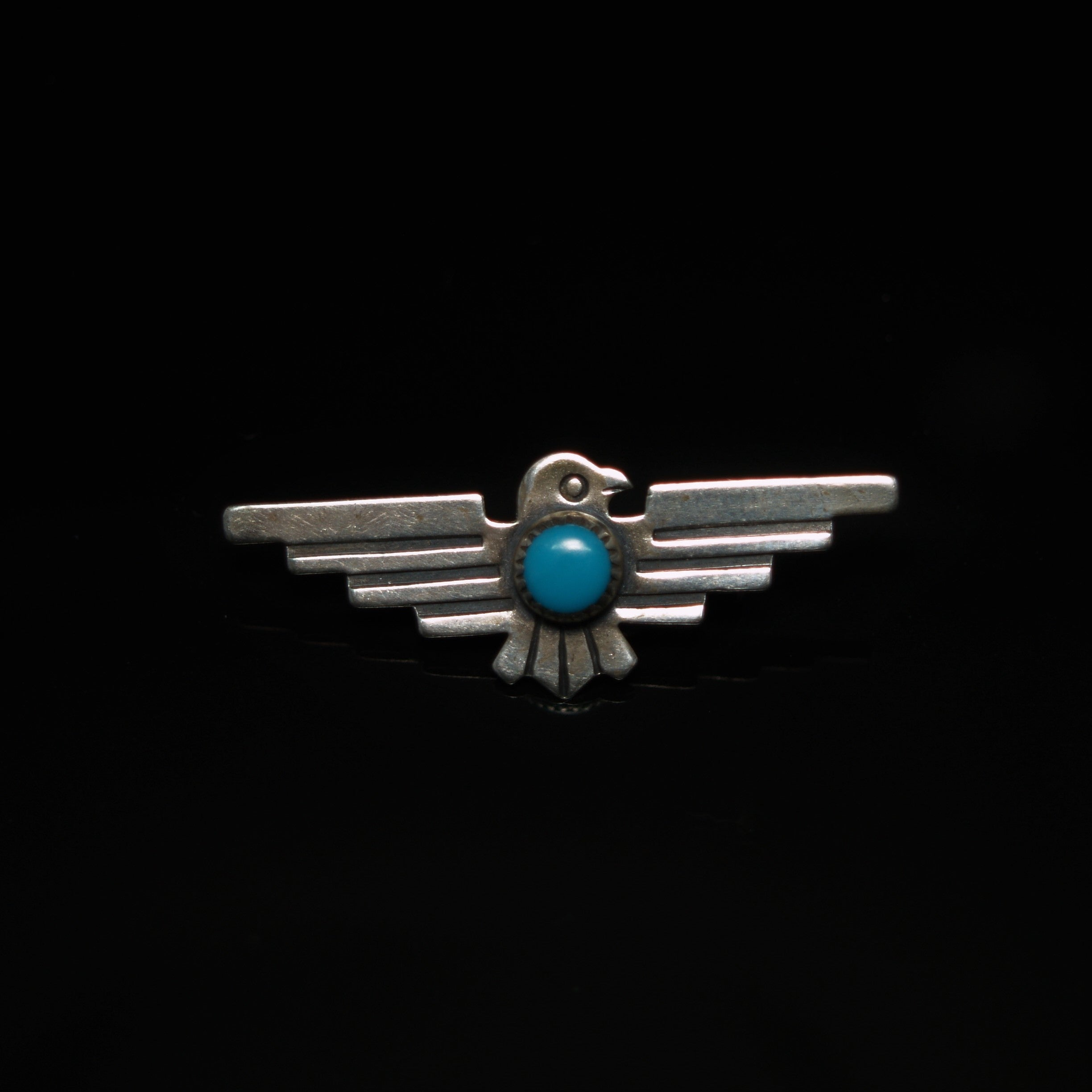 NAVAJO INDIAN SILVER & TURQUOISE THUNDERBIRD BROOCH.