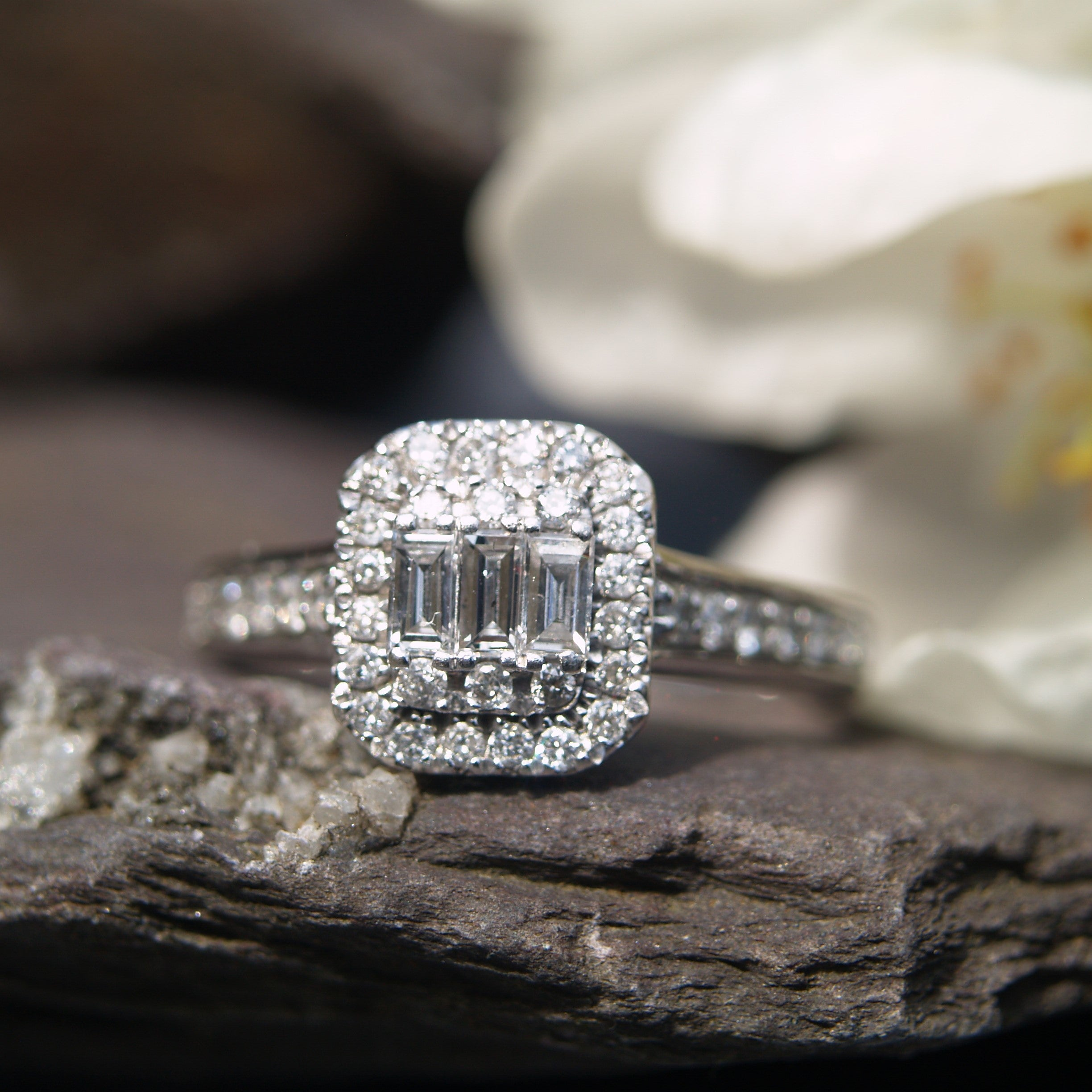 9ct White Gold Diamond Baguette Halo Ring.