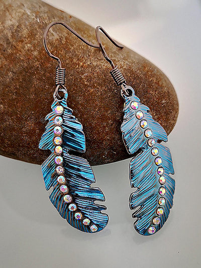 Fashionable boho earrings with colored diamonds