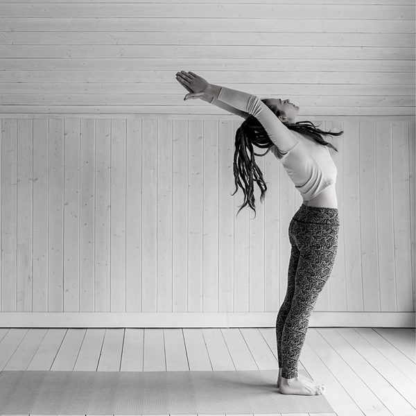 Woman unplugging while stretching
