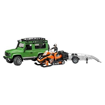 Land Rover Defender w trailer, snowmobile and skier