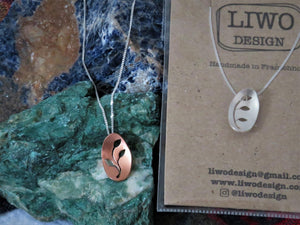 Necklace with Oval Pendant with Botanical Cut Out