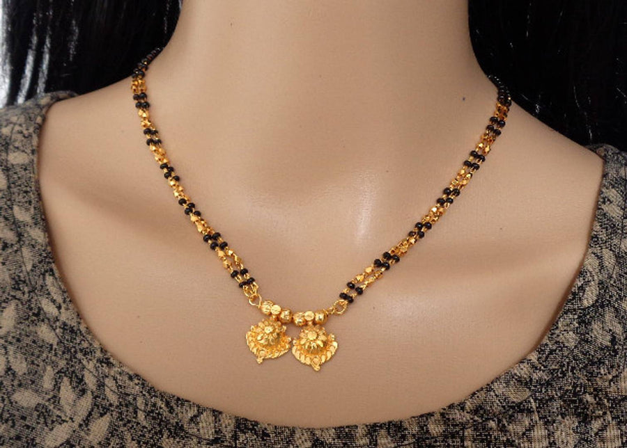 designer and stylish mangalsutra necklace and jewellery set for women and girls