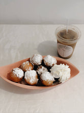 Load image into Gallery viewer, Heavenly delicious beignets (French for donuts, doughnuts) rested on a bed of your choice of Chantilly Cream. Topped with Caramel or Chocolate.