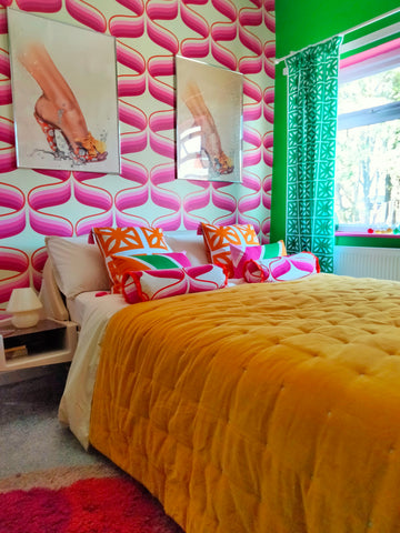 pink and green retro vintage wallpaper bedroom with space age james bond bed and breeze block design