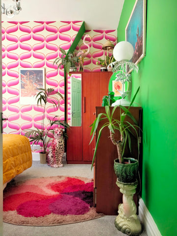 pink retro 70s wallpaper with green wall and pink frenchie ceramic leopard