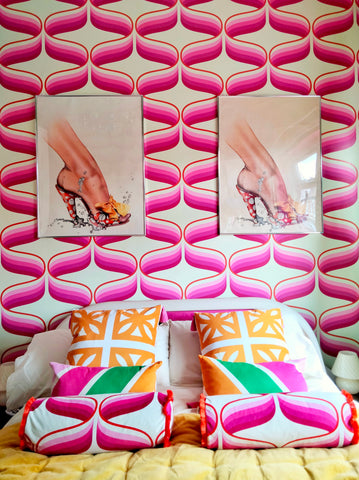 pink retro swirl wallpaper over 70s modular bed with breeze block cushions 70s retro location home