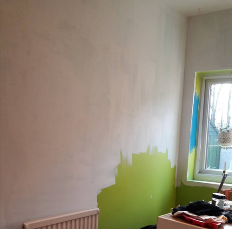 Painting a lime green wall white in a kitchen
