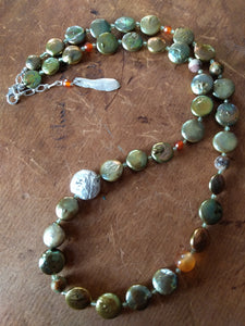 Green button pearl necklace with tiny peridot and carnelian and silver feather end charm