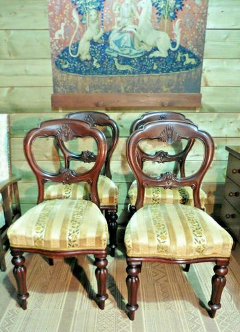 382.....A Set Of Four Antique Carved Mahogany Balloon Back Dining Chairs