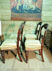 A Set Of Four Antique Carved Mahogany Balloon Back Dining Chairs