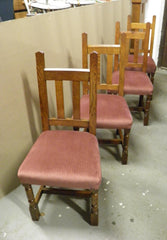A Set Of Four Arts And Crafts Oak Dining Chairs