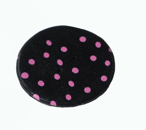 black with pink dots round button