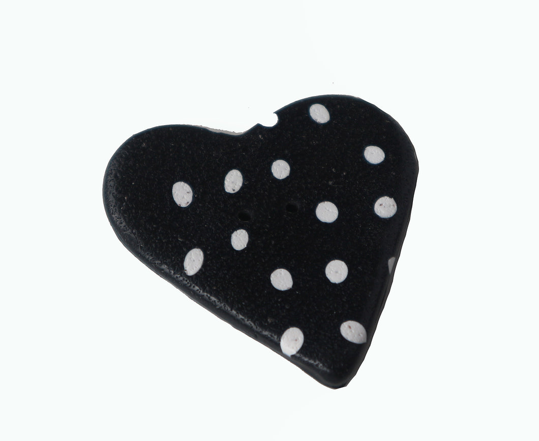 black heart shaped button with white dots