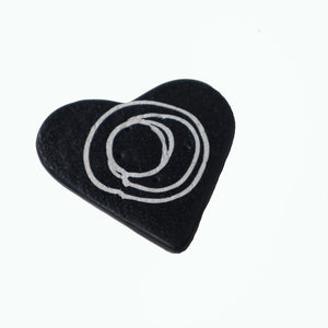black heart shaped button with white line swirls