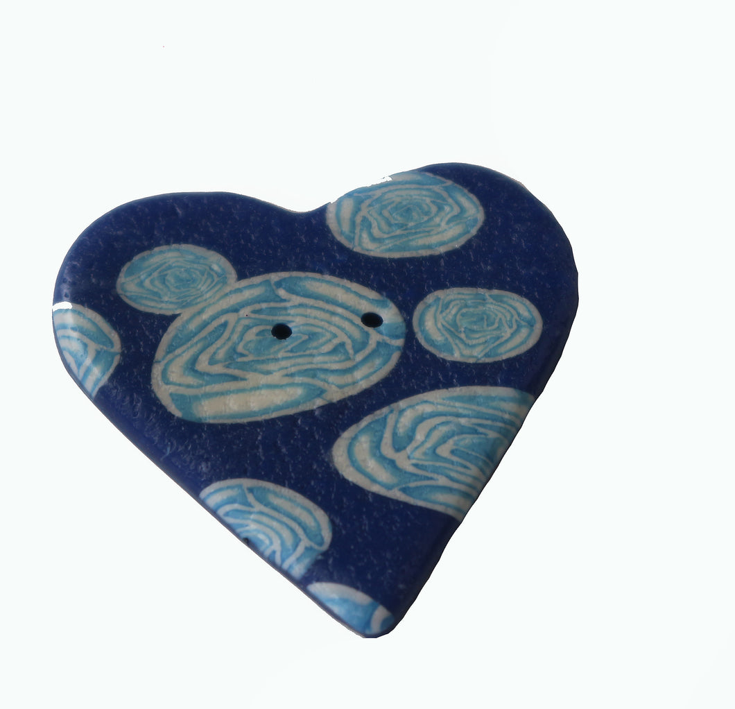blue heart shaped button with white flowers