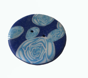 blue round button with white flowers